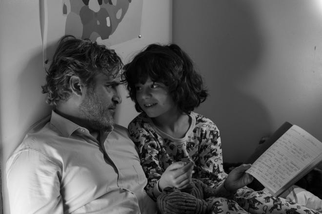 Joaquin Phoenix, left, plays uncle to Woody Norman in Mike Mills