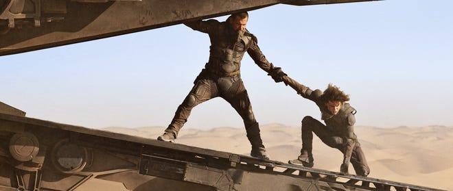 "Josh Brolin, left, and Timothy Chalamet on the scene of ""Dune."""