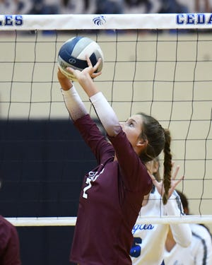 Bastrop's Brianna Mutschink sets the ball for a teammate during the Bears' win over Cedar Creek Tuesday.