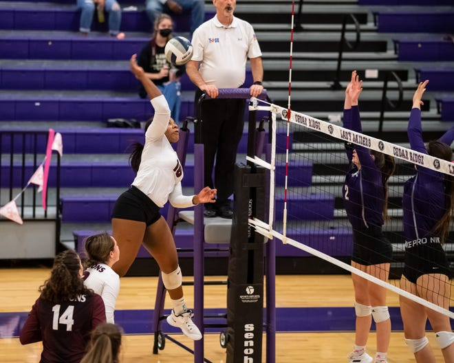 Briana Bailey goes up for a shot for Round Rock against Cedar Ridge. Round Rock won a District 25-6A match in three sets at Cedar Ridge High School on Oct. 12.