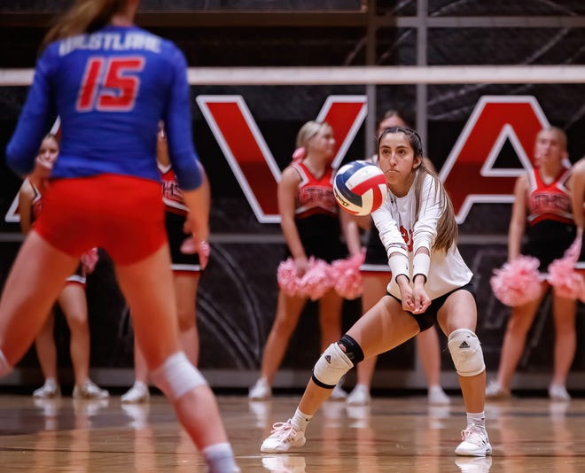 Lake Travis libero Emily Contreras passes the ball against the Westlake Chaparrals serve during the third set at the District 26-6A volleyball match on Oct. 12 at Lake Travis High School. The Cavs beat their rivals 3-0 for Coach Brandace Boren's 200th win at the school.