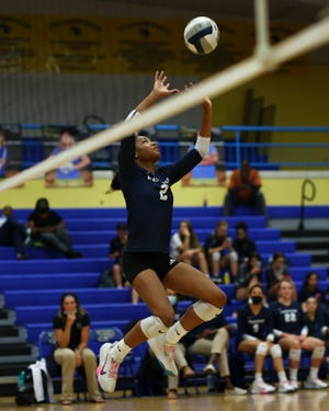 Hendrickson setter Karys Dove floats a set to a teammate in a match against Pflugerville on Tuesday at Pflugerville High School. Dove, who ranks fifth in the state in assists per set, had 28 as Hendrickson won to remain undefeated in district play.