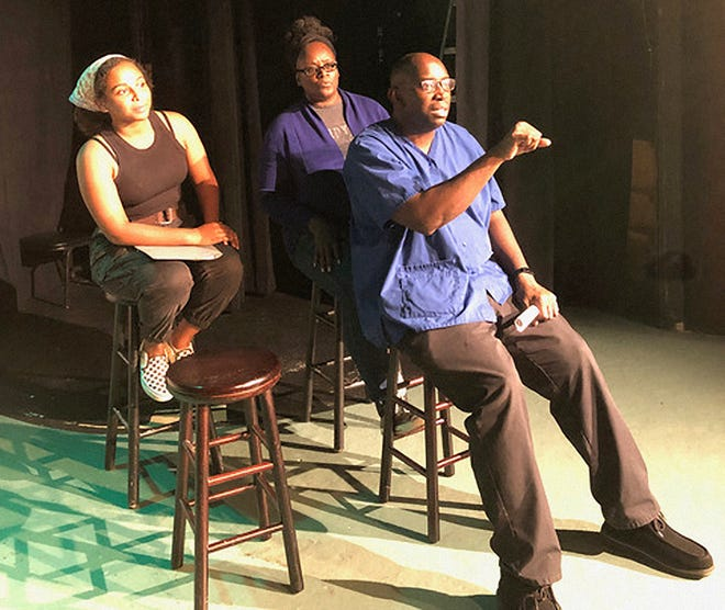 """(L-R) Actors Tatyanna Frye, Nikki Skies and Sean Polite rehearse a scene from """"Athens Vignettes,"""" opening at the Town & Gown Players community theater on Oct. 15, 2021."""