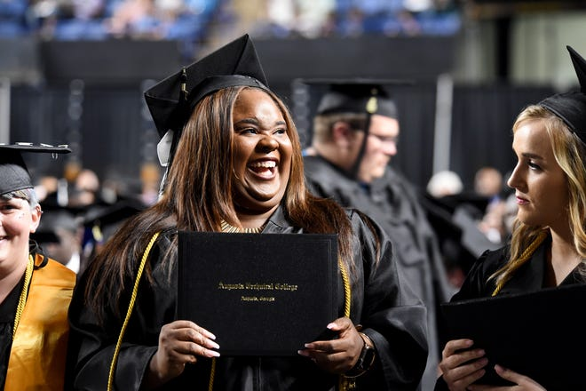In this photo from May 2019, Jessica Felix smiles after picking up her diploma during Augusta Technical College's commencement at the James Brown Arena in Augusta.
