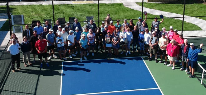 Barnstable Pickleball Club players and town officials dedicate the new courts Wednesday.