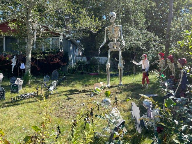 Skeletons overrun a Sandy Shore home near Shubael Pond.