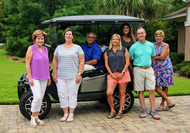 Hampton Lake residents Janice Thompson, Janice and Jimmy VanDerveer, Kristen Parson, Carol Branch, Dave Gallant and Eileen Faas have been organizing Friday's Hit 'Em Fore Herman charity golf event.