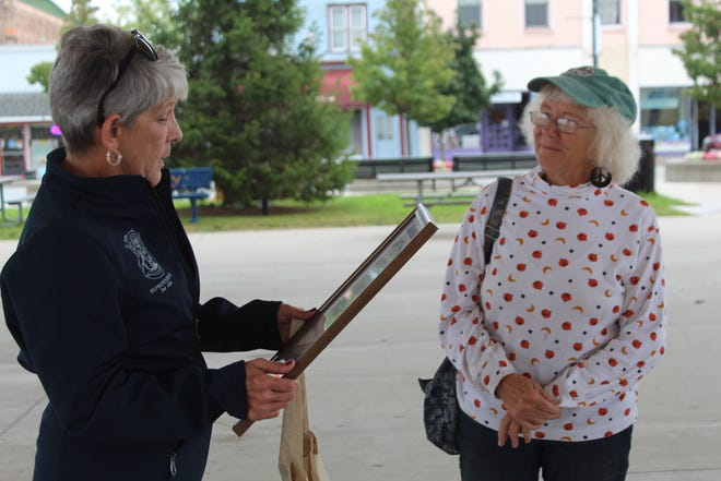 Last Friday, Michigan State Representative Sue Allor (left) presented Cheboygan resident Karen Martin (right) with a certificate of appreciation, recognizing her for all her efforts in cleaning up the forest and the trails on Alpena State Road for over 10 years.