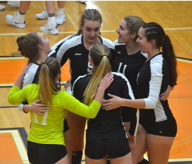 The Cheboygan varsity volleyball team held on for a 3-2 victory at St. Ignace on Tuesday.