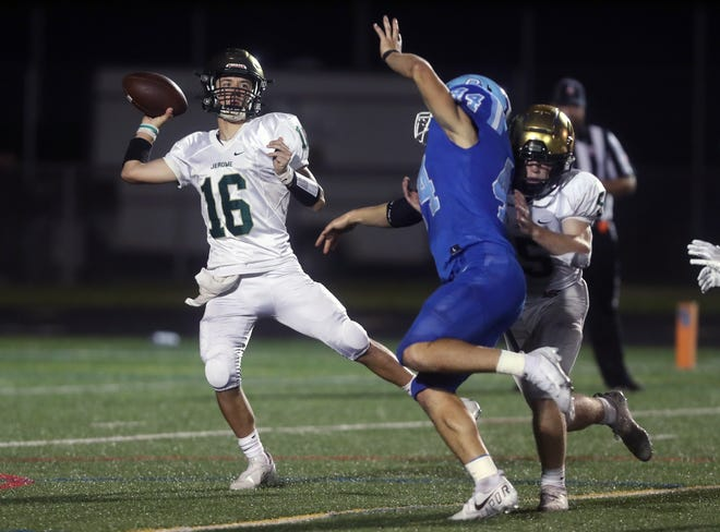 Dublin Jerome's Zakk Tschirhart throws from his back foot to avoid pressure from Olentangy Berlin's Kyle Jackowski during the visiting Celtics' 22-21 loss Oct. 8.