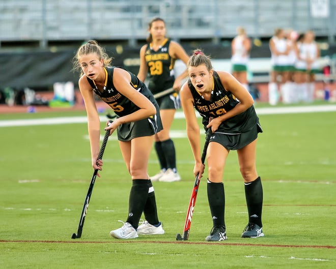 Emily Barker (left) and Brooke Stauffer have helped the Upper Arlington field hockey team put together a strong season. The Golden Bears are 11-3-1 overall and 7-0 in the COFHL-West.
