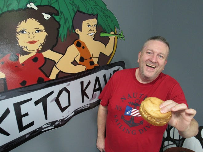 Brian Van Ness holds up a ketogenic-friendly cheesecake at his store, the Keto Kave, 4818 N. High St. in Clintonville. Van Ness and his wife, Susan, opened the Keto Kafe two years ago in downtown Newark to serve those who embrace a keto diet.