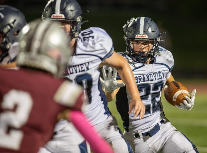 Grandview Heights' Jake Leach follows his blockers against Columbus Academy on Oct. 8. Grandview plays Ready on Oct. 15, while Academy faces Bexley.