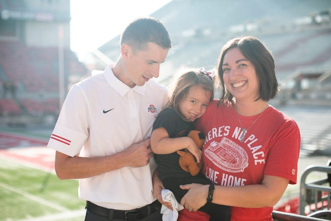 Jason Browning at Ohio Stadium, where he is a building coordinator, with his wife, Britta, and their 3-year-old daughter, Nora, who was born 10 weeks premature. Jason is running the Nationwide Children's Hospital Columbus Marathon, where his daughter will be a Patient Champion.