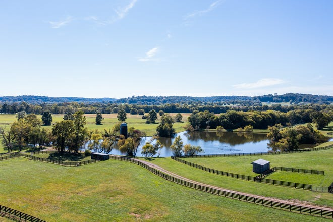 The historic Samuel S. Morton property includes a farm, serene pond, 13-stall barn and a historic log home built in 1850.