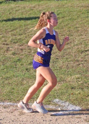 Bronson senior Abby Ware battle her way to a 14th place finish at Tuesday's Big 8 Jamboree