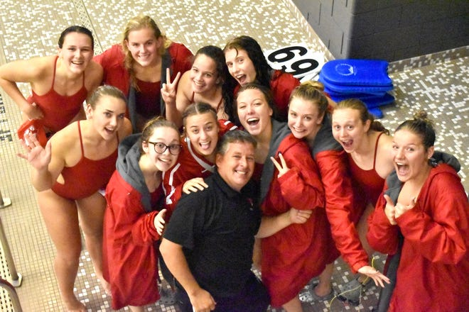 The Coldwater Lady Cardinal and Dive seniors take a moment with coach Marsh during their win Tuesday