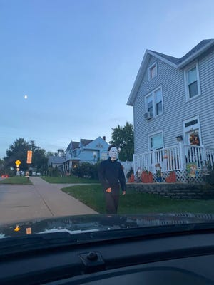 Police responded Tuesday to a report of a man walking around the streets of Burlington in a Michael Myers costume.