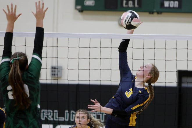 Notre Dame High School's Josie Bentz (3) spikes the ball during the second set of their match against West Burlington High School Tuesday Oct. 12, 2021 in West Burlington.