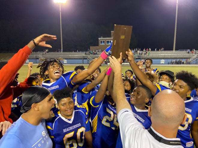 Southwest Middle School football players accept the Gaston County Middle football championship plaque from Gaston County athletic director Chad Duncan following Tuesday's 16-8 win over Belmont.