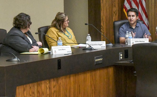 Isidro Marino, right, answers a question as Lara Bors, left, and Jacqueline Gigot look on Tuesday during a Garen City Area Chamber of Commerce candidates forum at the Garden City Administrative Center. The forum was for candidates running for the USD 457 Board of Education.