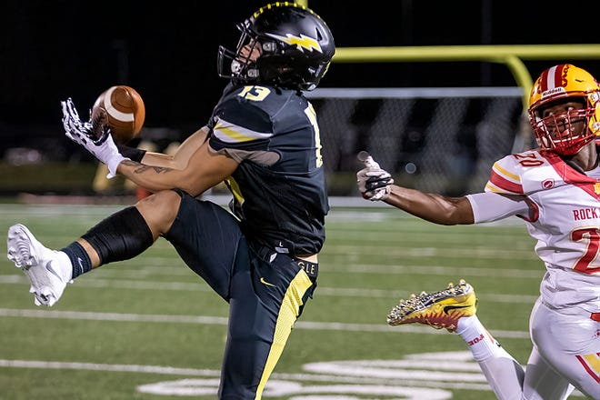 Galesburg High School senior wideout Dre Egipciaco makes a catch against Rock Island on Friday, Oct. 1 at Van Dyke Field. The Silver Streaks fell to the Rocks 33-30 in overtime.