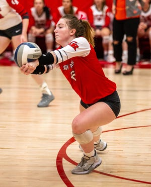 Glen Rose libero Cam Hinton records one of her 20 digs in the loss to the Spartans on Tuesday night.