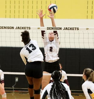 Sherman's Samantha Graham puts up a block on Denison's K'Zaria Butler in the Lady Bearcats' win in District 10-5A play at Denison.