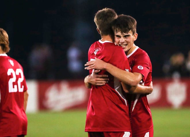 Indiana's Tommy Mihallic, right, gets a hug from teammate Victor Bezerra following a first-half goal for the Hoosiers in a 3-0 win over Ohio State Tuesday night at Armstrong Stadium.