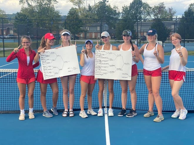 Hendersonville's girls tennis team poses after winning the Mountain Foothills Conference tournament title on Tuesday at Brevard College.