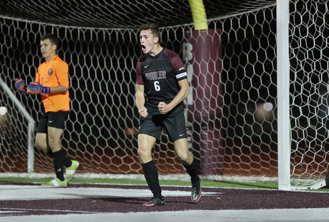 Buhler's Cooper Taylor (6) celebrates the game-winning goal he scored against McPherson Tuesday evening, Oct. 12, 2021. Buhler defeated McPherson 2-1.