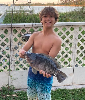 Tripp Aycock, 13, of Lakeland, caught this 5-pound tilapia on a dough ball while fishing at Lake Jessie this past week.