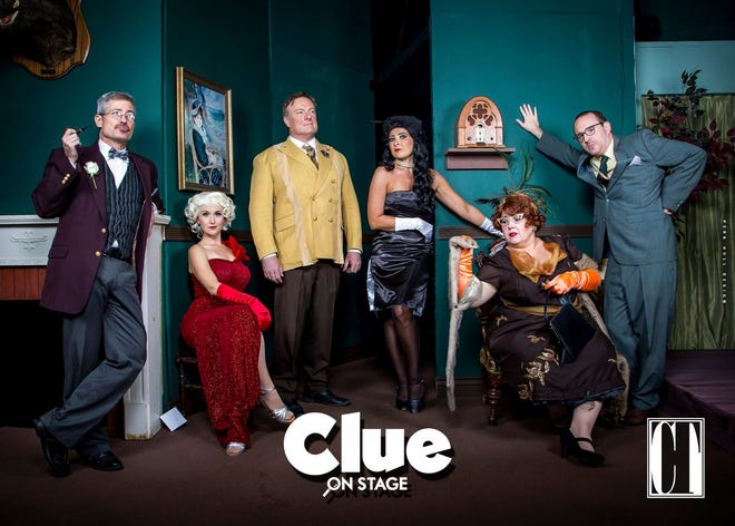 """The cast of """"Clue"""" poses for a photo on set."""