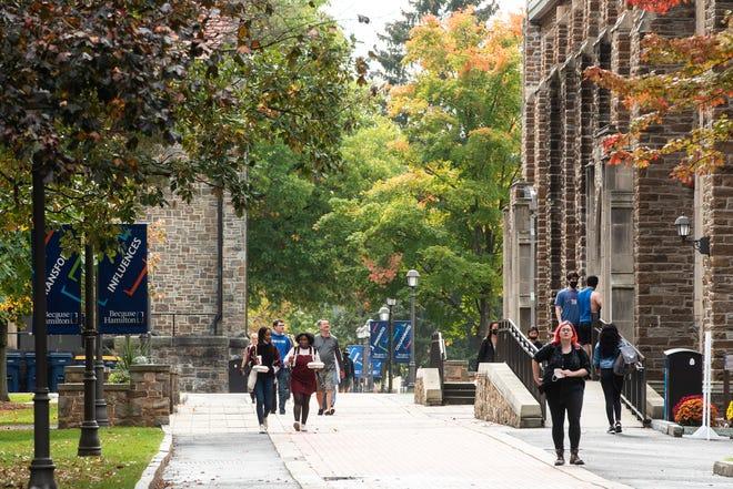 Hamilton College students walk around campus on Wednesday, Oct. 13, 2021.