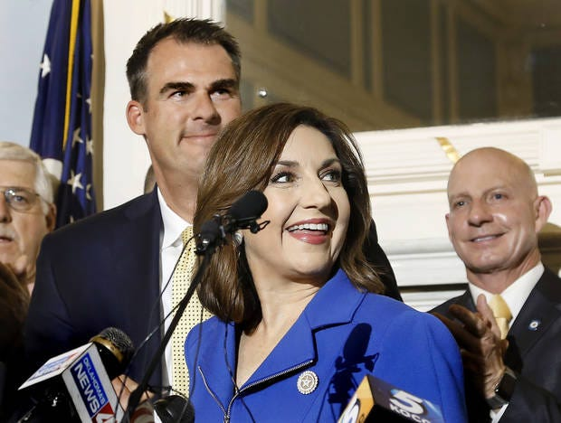 State schools Superintendent Joy Hofmeister and Gov. Kevin Stitt, left, smile after the Oklahoma Legislature announced a budget agreement at a news conference May 15, 2019.