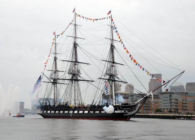 The USS Constitution celebrated the Navy's 246th birthday with a 21-gun salute Wednesday.