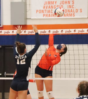 Pontiac's Ellie Wright takes a swing at the ball in making an attack against Olympia on Tuesday. Wright had 4 kills as the Indians prevailed in two sets.