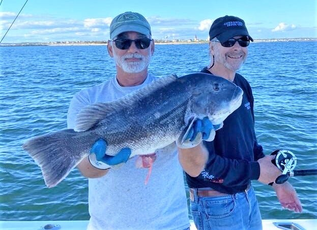 John Stavrakas of South Kingstown with the 22-inch, 7-pound tautog he caught off Point Judith last week with his friend, John Jeffries, of Fort Salonga, N.Y.