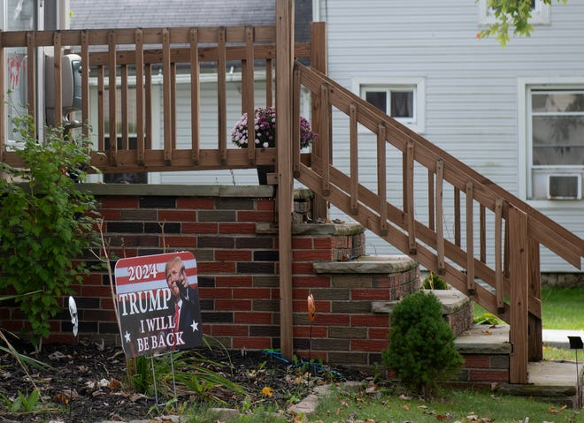 A sign in a Ravenna yard promotes former President Trump, even though he's not on the ballot. Regulations on when political signs can be placed in yards have been found to be unconstitutional. Other signs, which use profanity to refer to a politician, have been deemed offensive, but the city's law director says they're protected as free speech.