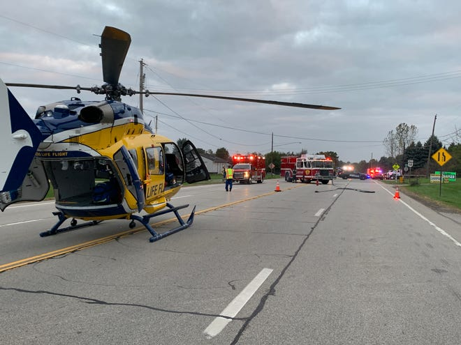 A Metro Life Flight helicopter stages on State Route 14 at Price Road at the city's east limits as crews from Streetsboro Fire Department and Metro Life Flight prepare to transfer a man suffering multiple traumatic injuries following a two-vehicle crash from the ambulance to the helicopter.