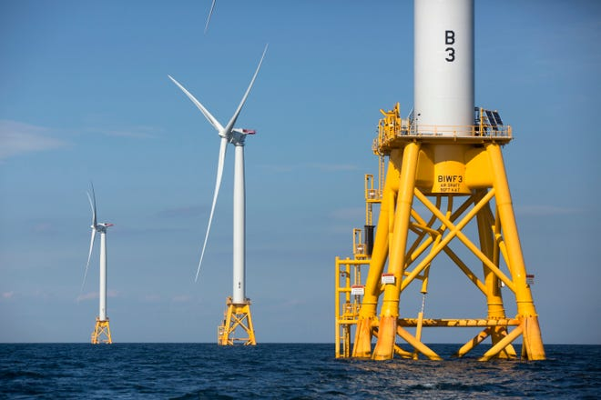 Three of Deepwater Wind's five turbines stand in the water off Block Island, R.I, Aug. 15, 2016, the nation's first offshore wind farm.