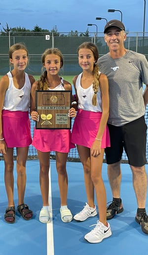 The Renfro family of Claire, Addison, Mallory and Clark pose for a photo after claiming a Class 5A regional championship on Saturday in Newton.