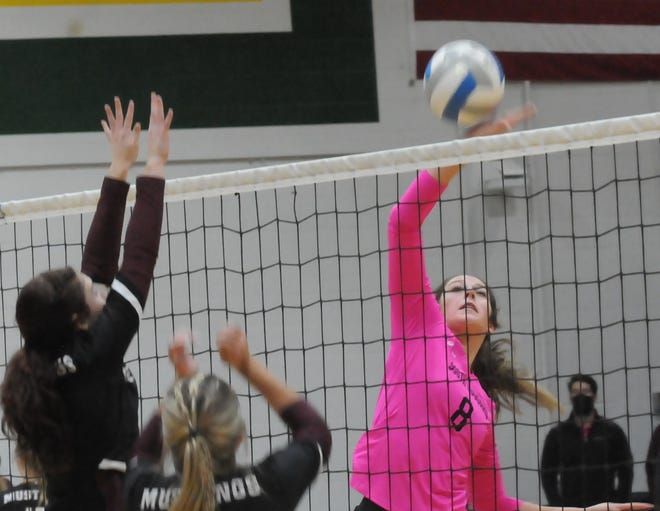 Salina South's Baylee Brin (8) spikes the ball over the net during Tuesday's match against Salina Central at the South gym.