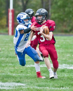 Brimley's Dominic Morrison (20) chases an Ironwood player during a football game this past Friday night. Morrison led the Bays in tackles against the Red Devils.