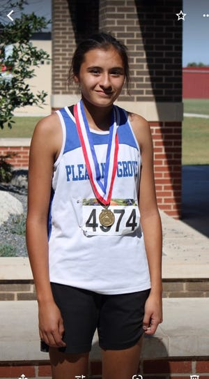 Daley Rice poses after taking first at the recent ORES State Cross Country Meet.
