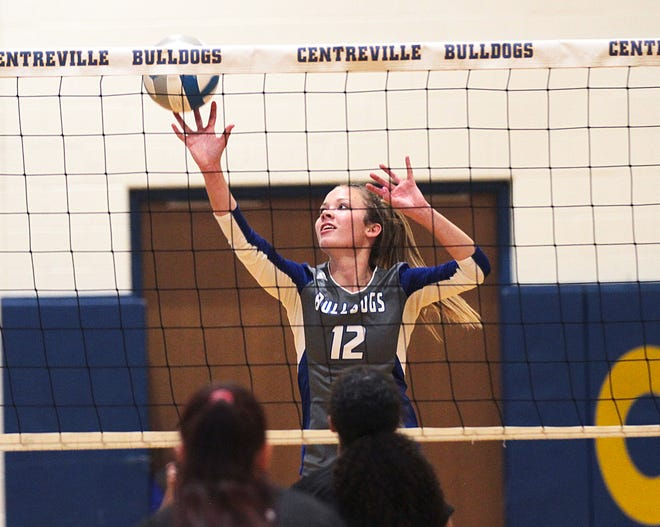 Sabrina Spence of Centreville tips a ball back over the net against Cassopolis in prep volleyball action on Tuesday.