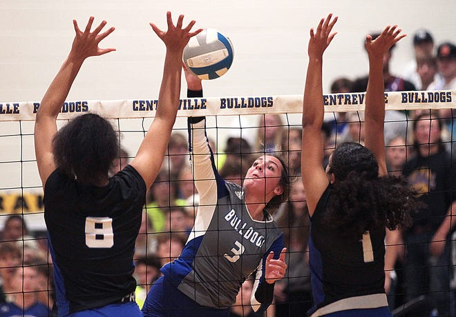 Centreville's Sarah Stauffer registers a kill between a pair of Cassopolis blockers on Tuesday evening.