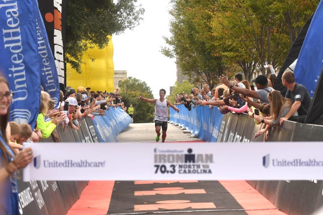 Matias Palavecino nears the finish line of the 2019 Ironman 70.3 North Carolina. It was the last time the race was held, and it returns on Saturday, Oct. 23, with 2,700 competitors expected. STARNEWS FILE PHOTO