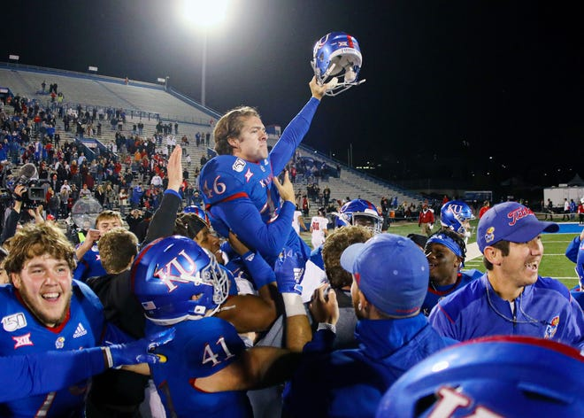 In this 2019 file photo, Kansas kicker Liam Jones (46) is carried around the field after kicking the game-winning field goal against Texas Tech at David Booth Kansas Memorial Stadium.