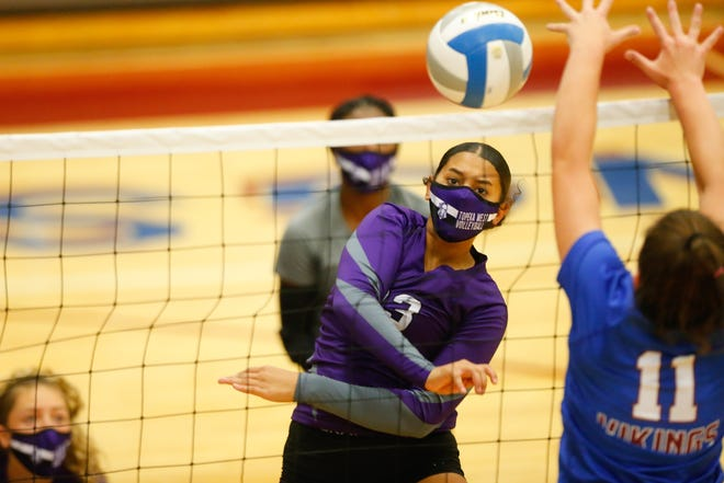Topeka West sophomore Brooklyn Alexander (23) returns with a spike to Seaman during the Chargers first set at Tuesday's match.